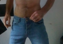 Picture of bare man unbuttoning his jeans