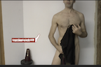 video thumbnail of naked man holding jacket in front of body