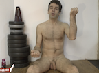 video thumbnail of naked man sitting on floor
