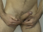 Thumbnail of video showing erect penis and fingers touching testicles