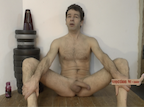 Thumbnail of video showing erection dr naked sitting on floor, legs wide with erect penis